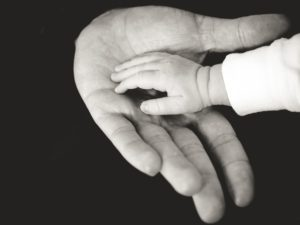 b and w hand in hand